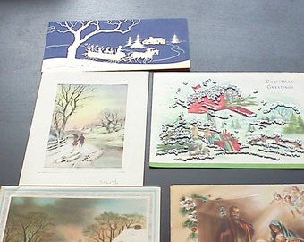 Five used vintage Christmas cards.  Horse and sleigh, rabbits, Christmas packages, snow, Nativity scene.