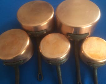 Vintage French copper saucepan set