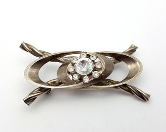 Large Modern Silver Tone Metal Brooch Oval with Criss Cross Braid and Clear Rhinestone Center Vintage 80s Modernist Runway statement jewelry