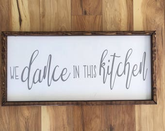 """We Dance in This Kitchen Framed Sign - 24""""x12"""""""