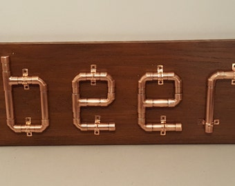 Copper pipe beer sign