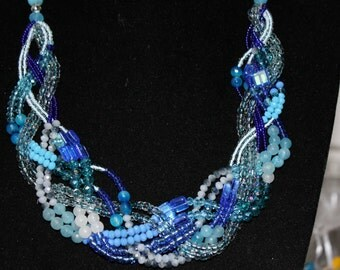 Necklace neckline with pearls, beads, crystals and semiprecious stones entwined blue