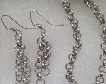 Silver tone bracelet and earrings set