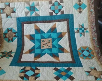 White, turquoise and brown, hand quilted, queen size quilt