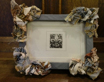 SOLD - The fabric flower fabulous frame!  Each frame with a 5'x7' mount is covered in sumptuous fabrics and hand sewn fabric flowers.