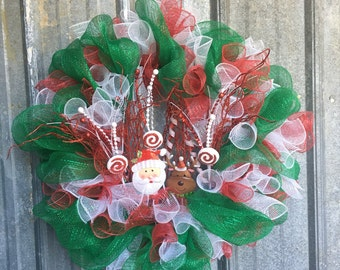 """24"""" Whimsy Santa and Reindeer Deco Mesh Wreath with Red, White, & Green"""