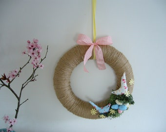 Large handmade Easter wreath, with jute, fabric birds and reindeer moss nest with eggs.
