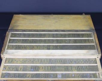A Vintage 'KULHMANN' Brass Printing Set