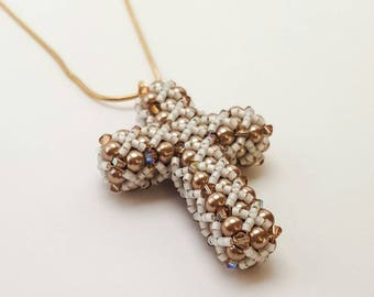 Beaded cross with Light Brown Pearls, Swarovski crystal bicones, and size 15 Miyuki Delica seed bead Necklace
