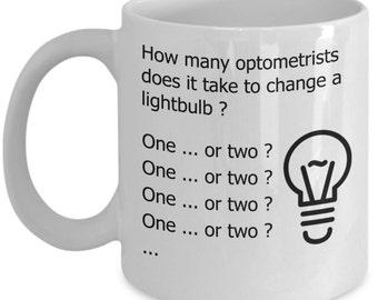 Optometrist Mugs - How Many Optometrists Does It Take To Change A Lightbulb - Funny Optometry Gifts