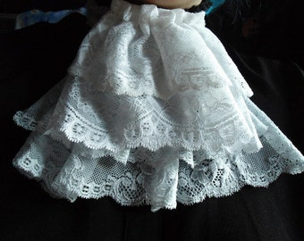 in white lace jabot / very light blue