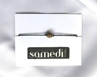 Shaped golden pearl bracelet