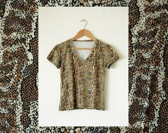 SALES * 20% off the snake skin tee