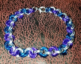 Chainmail jewelry anklet.  Purple and blue rosettes with silver connections.