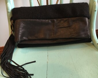 Black leather and wool  clutch