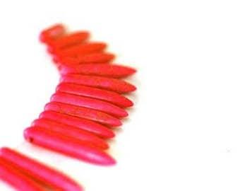 spikes/red spikes in Howlite gemstone