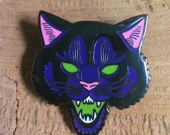 Black cat hissing