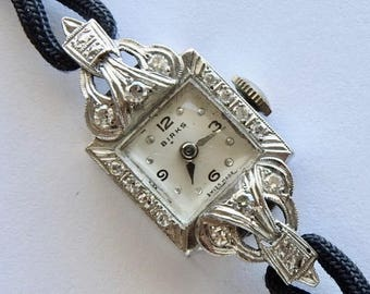 Vintage Retro Birks Platinum Diamond Swiss made Watch with 17 Jewels and Mechanical Movement. Circa 1940's -50's
