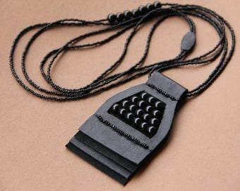 A necklace with a pendant made of genuine leather