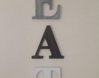 Eat letters dark grey, black, & light grey. Kitchen decor