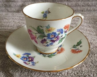 Royal Chelsea demitasse tea cup and saucer, pretty flower print on white with gold trim