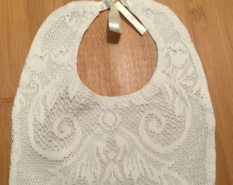 Accessorize with this cream baby bib, baby baptism bib, or special occasion baby bib. Ideal for baby shower gift.