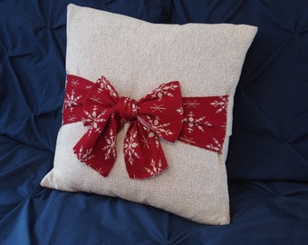 "light gray knit pillow with red bow 18""x18"""