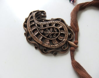 Hand carved paisley pendant