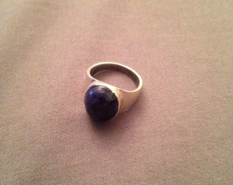 Size 2.75 sterling silver ring with blue stone
