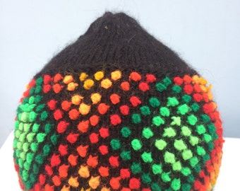 Multi coloured knitted beanie with tassel