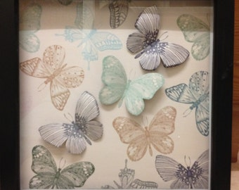 Frame with handmade butterfly decoration