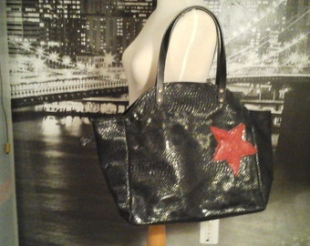 "Black and red leather tote bag worn hand where shoulder ""Red Star"""