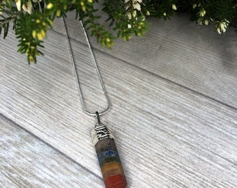 Chakra Crystal Pendant on silver plated chain.