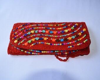 Elegant handcraft clutch with mutli color bead work