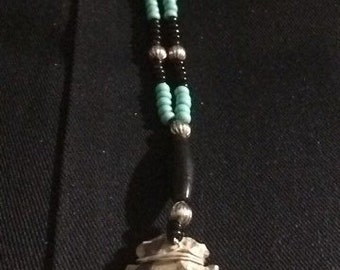 Baby blue deep chocolate beaded arrowhead necklace