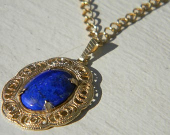 Hand-cut genuine Lapis Lazuli pendant necklace with gold-plated setting and chain