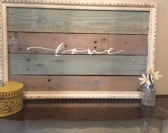 Love sign, multicolor pallets, vintage frame