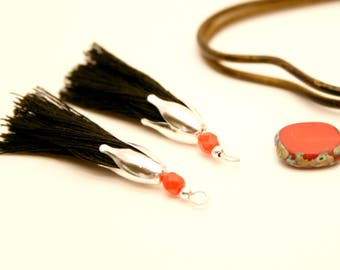 2 black PomPoms, Pearl faceted red, flower silver cap