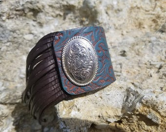 Fringe with concho brown and turquoise leather cuff