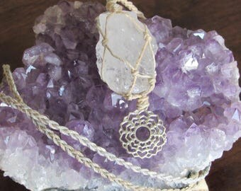 An Adjustable Sandalwood Macrame (Knotted) Hemp Necklace with Two Pendants: a Rough Clear Quartz Crystal and a Crown Chakra Symbol,  CLQ#16