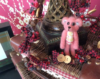 Pink wool felt bear , needle felted with pure wool, and given tartan paws and tummy.