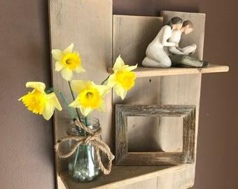 Wall shelf made of reclaimed wood. Reclaimed wood shelf unit.