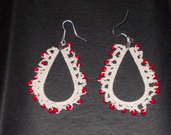 Handmade crochet teardrop earrings done in white cotton with red beads.