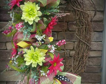 "24"" grapevine in hot pink, lime green, white , yellow and black."