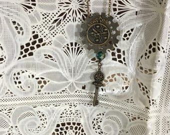 Steampunk gears and time piece handmade necklace