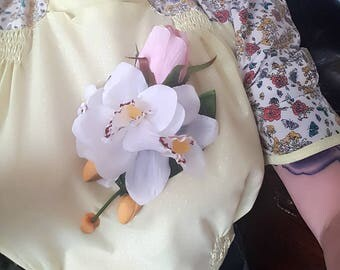 Pale pink rose and white orchid corsage