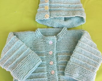 Knitted childs sweater and hat