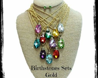 Gold Birthstone necklace and matching earrings.