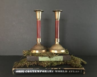 Brass candlestick holders with wooden detail