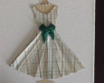Two Full Skirted Paper Dresses on Dress Form